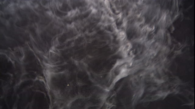 smoke from a smoke machine disperses against a black background. - fog stock videos & royalty-free footage