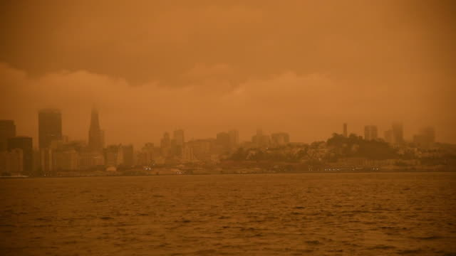 smoke from california wildfires hangs over the bay bridge, alcatraz, and the skyline of san francisco, california, usa on wednesday september 9th,... - smoking stock videos & royalty-free footage