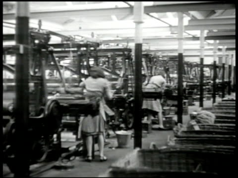 vidéos et rushes de smoke from factory int ws english women operating loom ms woman inserting spools into machine ws woman working w/ machine labor labour england - usine textile