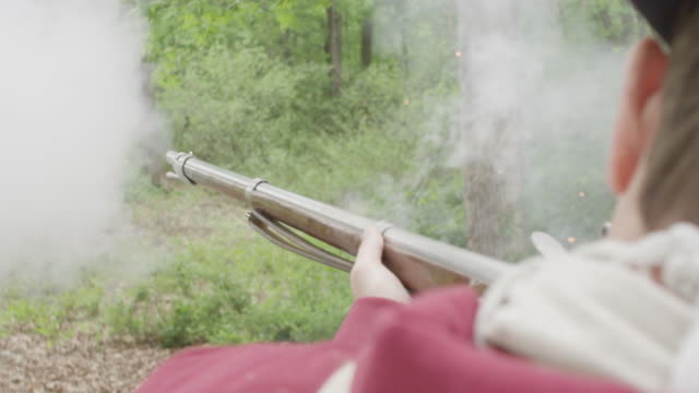 smoke from musket fired by revolutionary war soldier - rifle stock videos & royalty-free footage