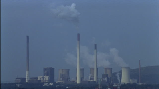 LONG SHOT smoke from smokestacks and steam from cooling towers of Scholven power plant, Gelsenkirchen-Scholven, Ruhr, North Rhine-Westphalia, Germany