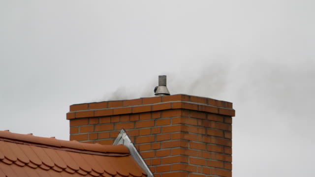 Smoke from the chimney in slow motion in 4k