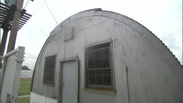 smoke leaks from an old barracks building. - barracks stock videos & royalty-free footage