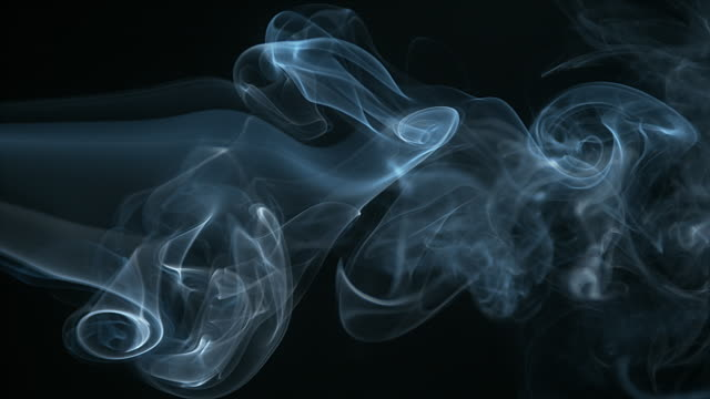 Smoke of Cigarette rising against Black Background, Slow Motion 4K