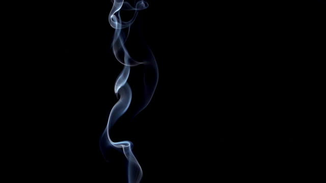 vidéos et rushes de smoke of cigarette rising against black background, slow motion - fumée