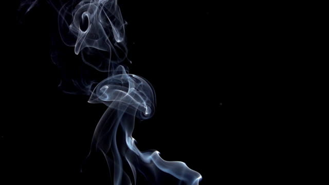 vidéos et rushes de smoke of cigarette rising against black background, slow motion - fumée structure physique