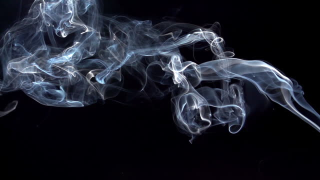 Smoke of Cigarette rising against Black Background, Slow Motion