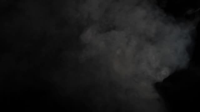 smoke on black background - medium shot stock videos & royalty-free footage