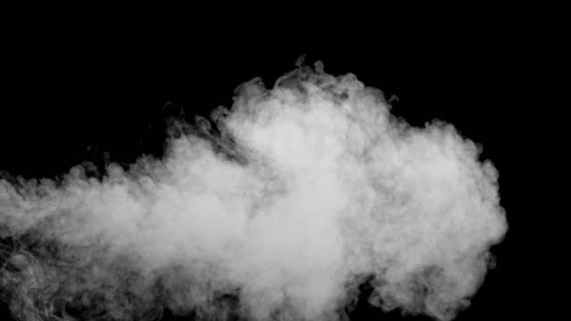slo mo smoke on black background - medium shot stock videos & royalty-free footage