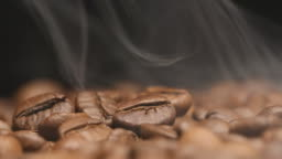 MACRO: Smoke over a roasted coffee beans (slow motion)