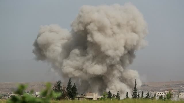 smoke plumes billow following reported syrian government forces bombardment in the southern countryside of the largely jihadist controlled region of... - air raid stock videos & royalty-free footage