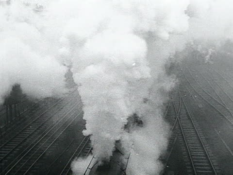 smoke pours from a steam train as it moves along the tracks - locomotive stock videos & royalty-free footage