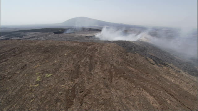 Smoke pours from craters on Ethiopia's Erta Ale volcano in an aerial view. Available in HD.