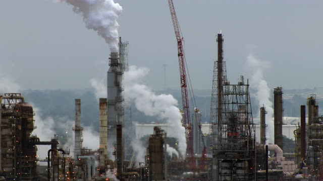 smoke pours into the sky from an oil refinery in baton rouge, louisiana. - oil refinery stock videos & royalty-free footage