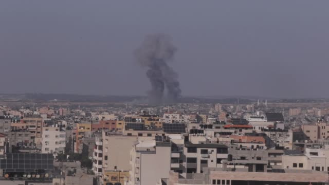smoke rises after an israeli air strike in gaza city, on may 05, 2019. - may stock videos & royalty-free footage
