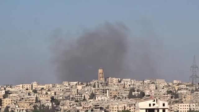 vidéos et rushes de smoke rises after russian army carried out an airstrike over opposition controlled kafr hamrah village of aleppo, syria on june 05, 2016. - bombardement