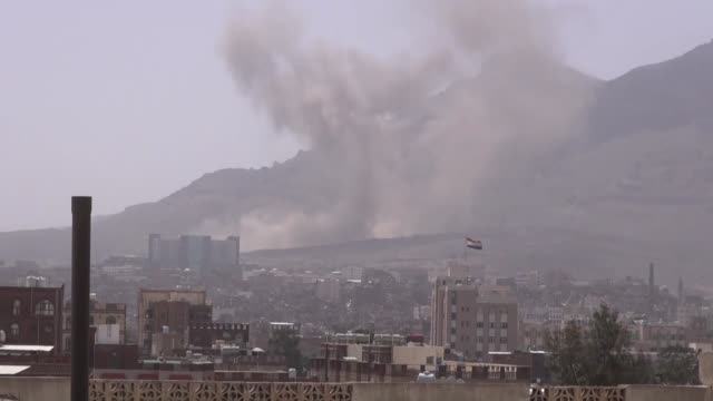 smoke rises after saudi-led coalition carried out airstrikes on the military camps of houthis around nukum mountain in sana'a, yemen on may 12, 2015. - yemen stock videos & royalty-free footage