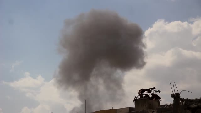 stockvideo's en b-roll-footage met smoke rises after syrian regime forces carried out an airstrike to deconflict zone ein tarma town of damascus syria on october 16 2017 - midden oosten
