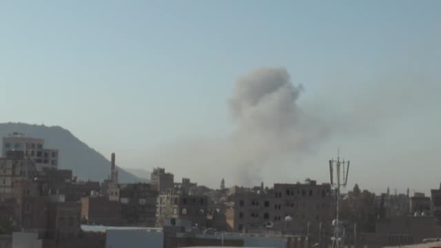 vídeos de stock e filmes b-roll de smoke rises after the war crafts belonging to the saudiled coalitions bomb hara and hurafi camps that belong to the houthis in sanaa yemen on... - coligação
