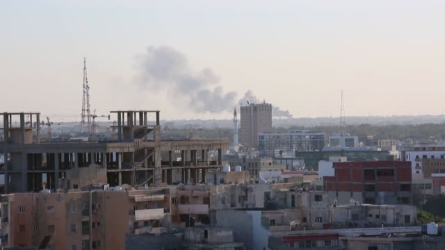 smoke rises after units of government of national accord destroyed armored vehicles of forces loyal to renegade commander khalifa haftar in southern... - damaged stock videos & royalty-free footage