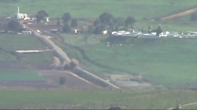 smoke rises and lebanese security forces patrol near the shebaa farms region at the junction between lebanon israel and syria following the shelling... - hezbollah stock videos & royalty-free footage