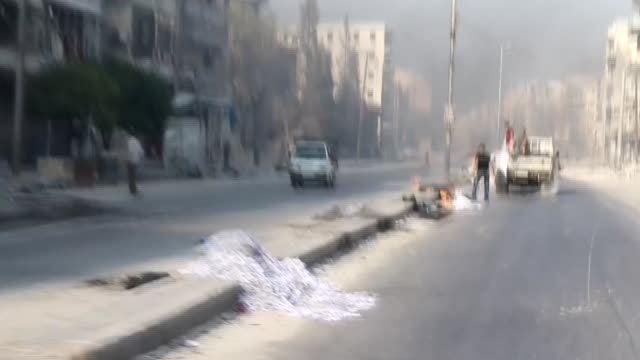 Smoke rises as Syrian opponents burn tires to block the ground visibility of the war crafts belonging to the Russian Army and Assad regime forces at...