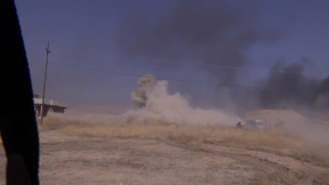 Smoke rises at Tercille village following a Deash suicide car bomb attack as Peshmerga forces deployed on Khazir front attack on Daesh targets during...