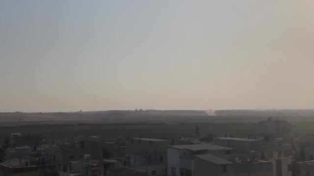 smoke rises at the site tal abyad town as turkish troops along with the syrian national army begin operation peace spring in northern syria against... - people's protection units stock videos & royalty-free footage