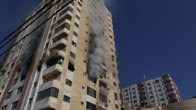 smoke rises following an explosion in gaza november 12 2019 israel's military killed a commander of palestinian militant group islamic jihad in a... - jihad stock videos & royalty-free footage
