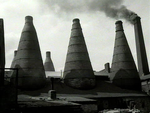 smoke rises from a large chimney at a pottery. - pottery stock videos & royalty-free footage