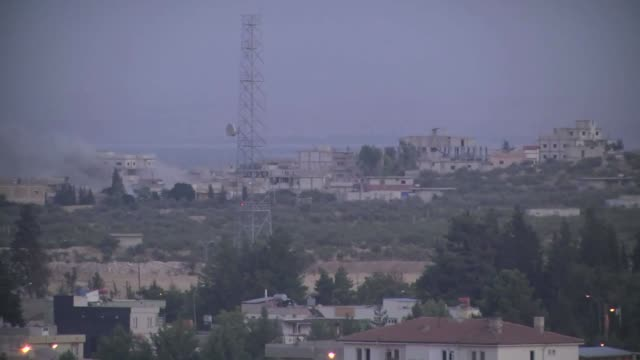 Smoke rises from a Turkish residential area on the Syrian border after mortar bombs landed on August 23 2016 in Gaziantep's Karkamis district which...