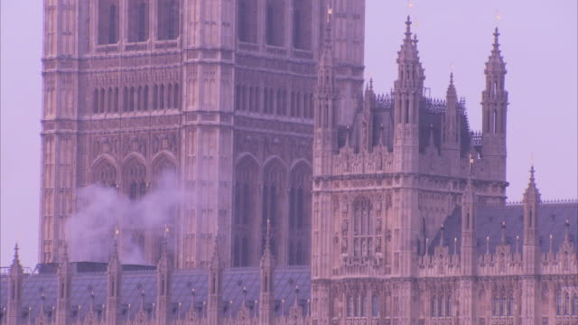 Smoke rises from a vent on the rooftop of the Houses of Parliament in London, England.