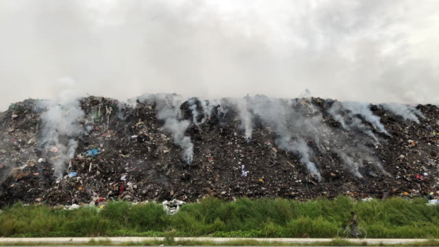 smoke rises from burning rubbish at a landfill site on the artificial island of thilafushi on december 11, 2019 near male, maldives. the site... - rubbish stock videos & royalty-free footage