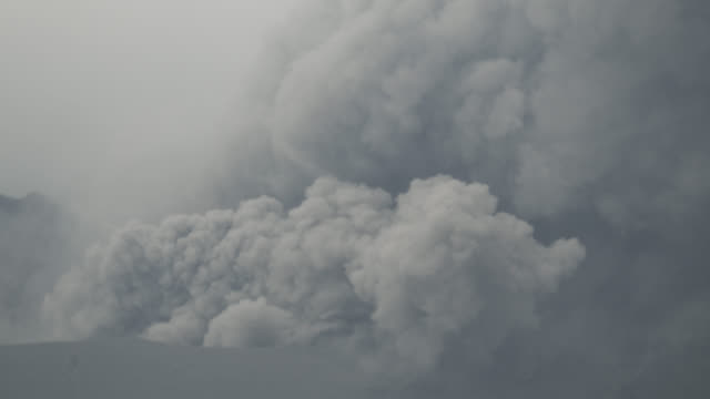 smoke rises from crater of sakurajima stratovolcano. - erupting stock videos & royalty-free footage