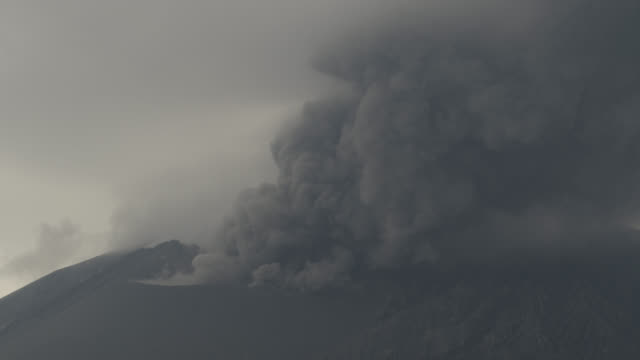 smoke rises from crater of sakurajima stratovolcano. - smoke physical structure stock videos & royalty-free footage