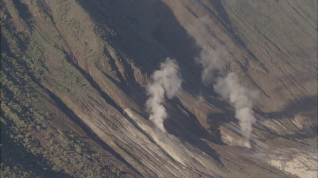Smoke rises from craters Available in HD.