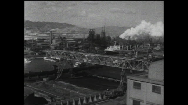 vídeos de stock, filmes e b-roll de smoke rises from steel mill chimneys in amagasaki. - indústria metalúrgica