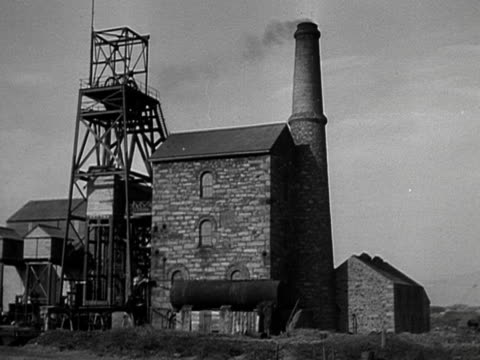 smoke rises from the chimney of a working cornish tin mine - cornwall england stock videos & royalty-free footage