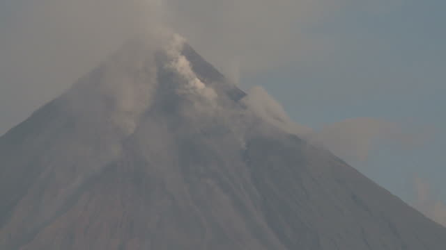 Smoke rises from the flanks of Mayon volcano, Philippines, December 2009