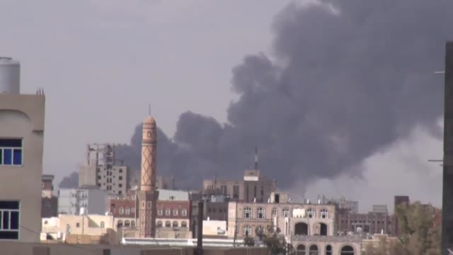 smoke rises from the sites belonging to houthis following the saudiled arab coalition airstrikes in sanaa yemen on february 01 2018 - luftangriff stock-videos und b-roll-filmmaterial