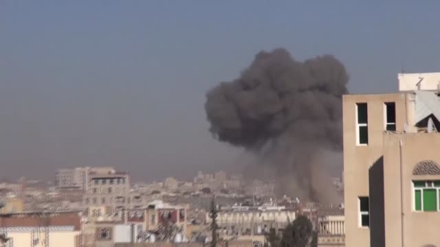 smoke rises from the sites of saudiled arab coalition airstrikes in sanaa yemen on december 20 2017 a saudiled arab coalition on wednesday conducted... - luftangriff stock-videos und b-roll-filmmaterial