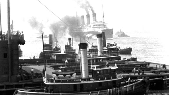 smoke rises from the smokestacks of tugboats and an ocean liner in new york harbor. - pier stock videos & royalty-free footage