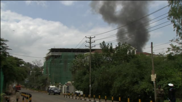 smoke rises from the westgate mall in nairobi, kenya as it is being attacked by the terrorist organization al-shabaab in 2013. - war or terrorism or military点の映像素材/bロール
