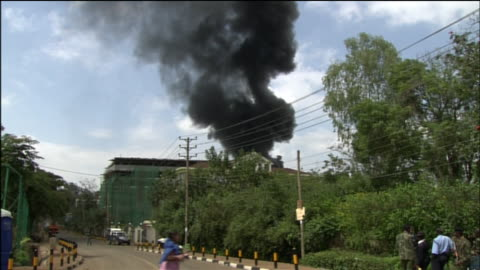smoke rises from the westgate mall in nairobi, kenya as that location is being attacked by the terrorist group al-shabaab in 2013. - war or terrorism or military stock videos & royalty-free footage