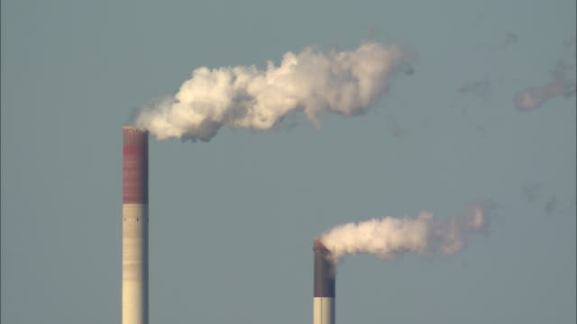 smoke rises from two smokestacks. - north rhine westphalia stock videos & royalty-free footage
