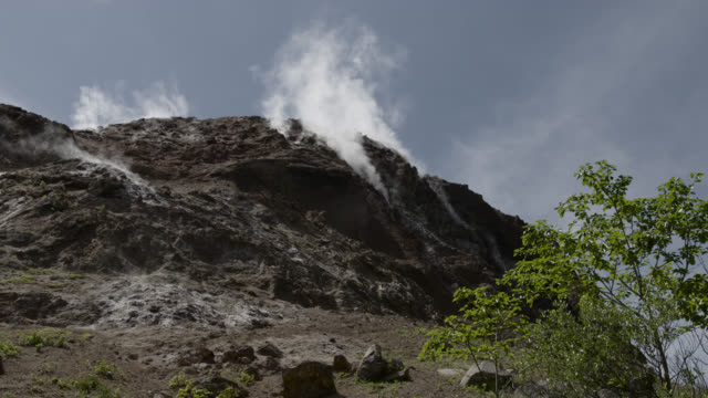 smoke rises from volcanic vents, japan. - volcano stock videos & royalty-free footage