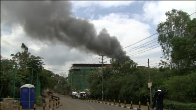 smoke rises from westgate mall in nairobi, kenya as it is being attacked by the terrorist group al-shabaab in 2013. - war or terrorism or military点の映像素材/bロール