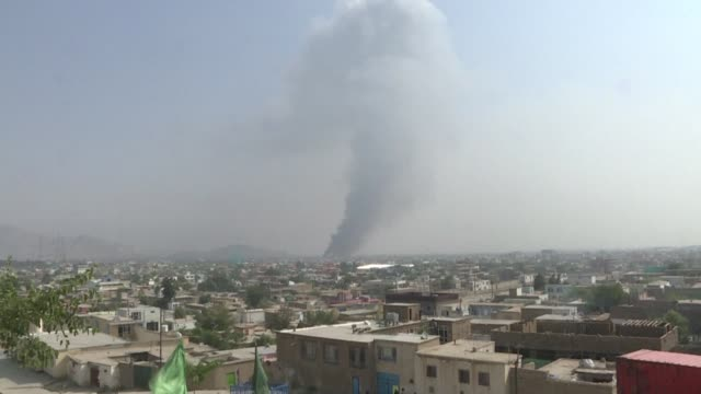 smoke rises in kabul in the aftermath of a massive explosion claimed by the taliban in a residential area that rocked the afghan capital late monday... - kabul stock videos & royalty-free footage