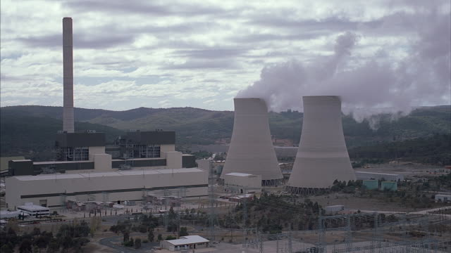 Smoke rises out of a nuclear power plant.