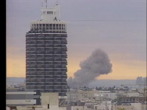 smoke rises over an israeli city during an air raid. - air raid video stock e b–roll